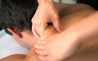 Osteopath treating a shoulder